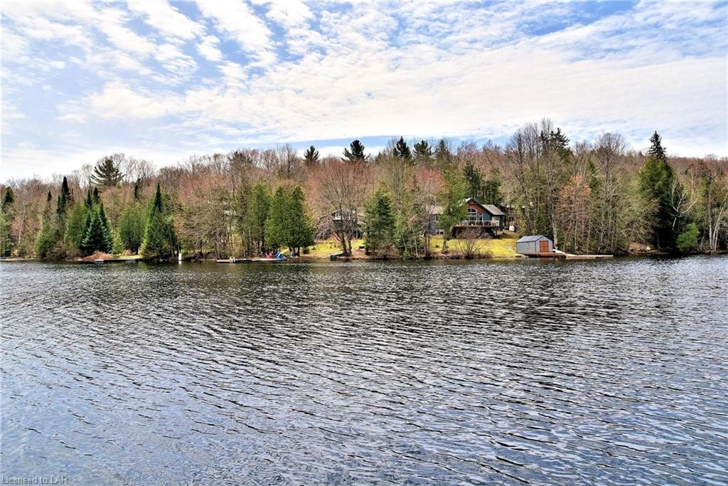 Cottage viewed from across Grass Lake in Haliburton