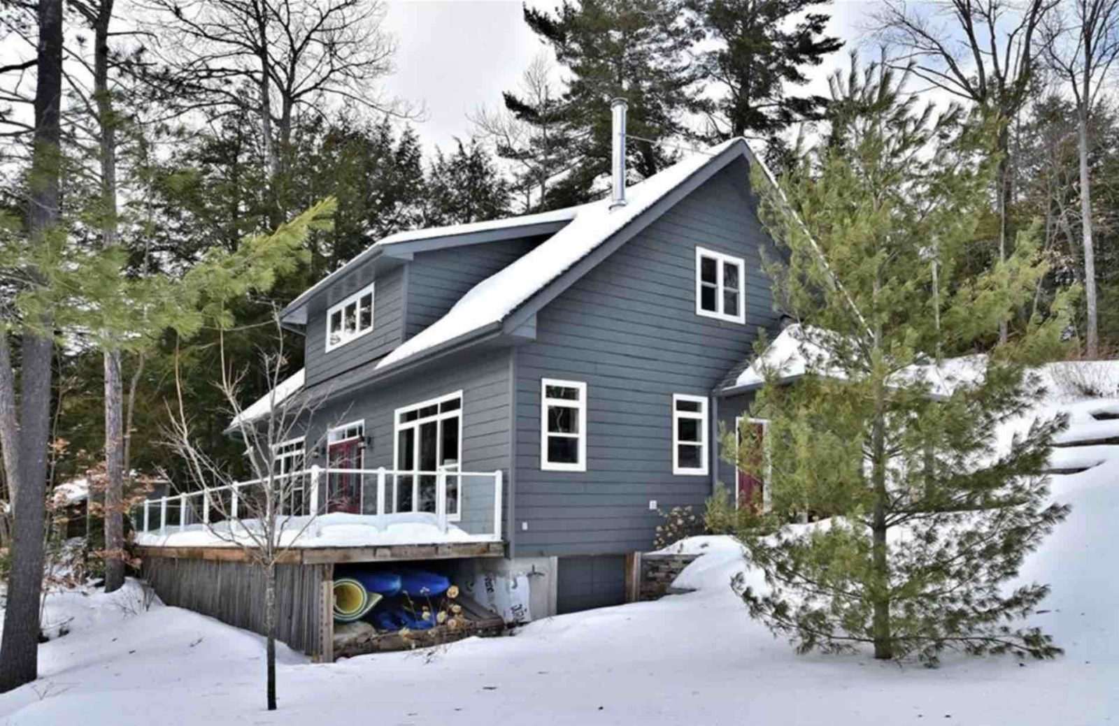 Exterior view of Kennisis Lake cottage in winter and snow